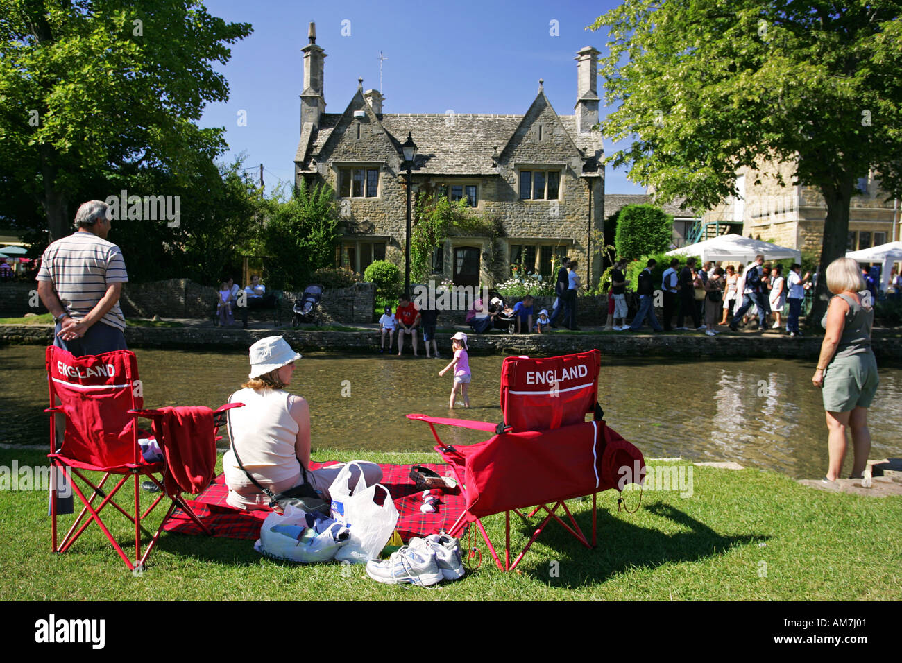 Patriotic English Family Picnic On Red Chairs With England