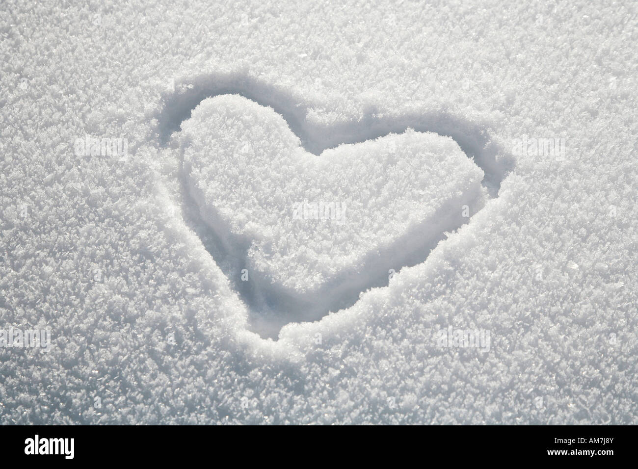 Heart written in the snow - Stock Image