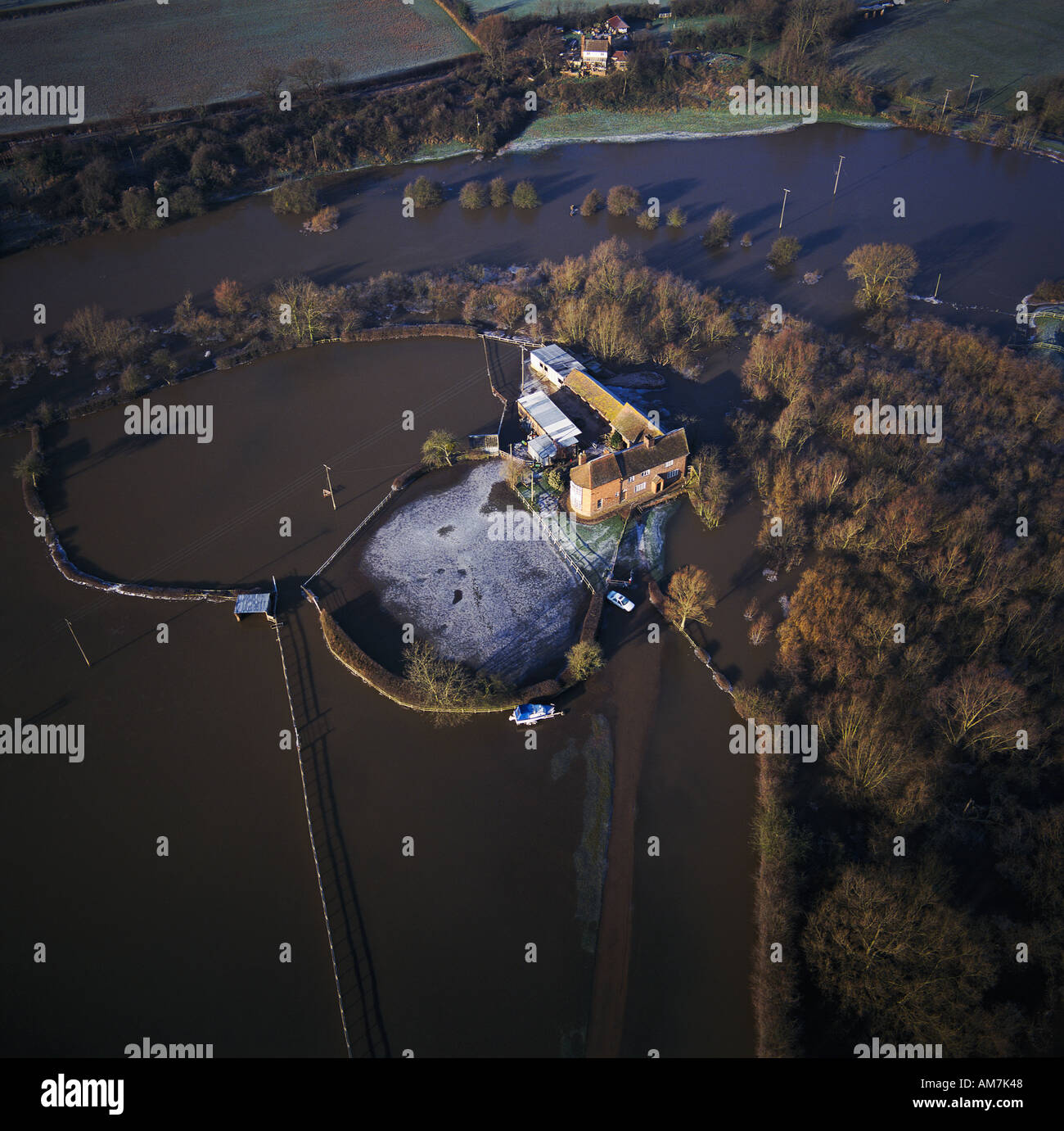 House isolated by winter floods aerial view UK - Stock Image