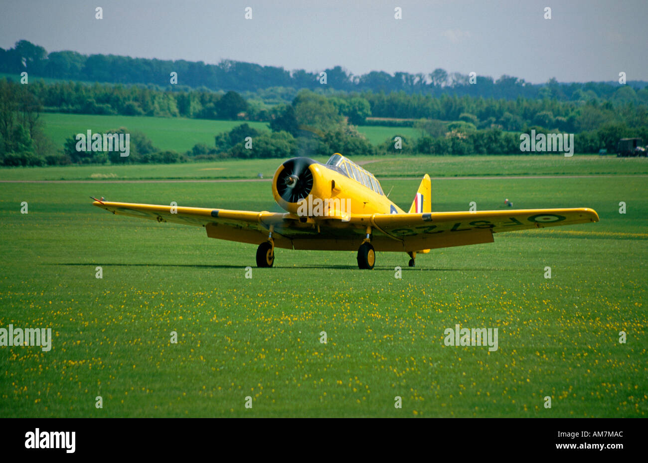 Yellow propellor driven historic aircraft at Middle Wallop - Stock Image