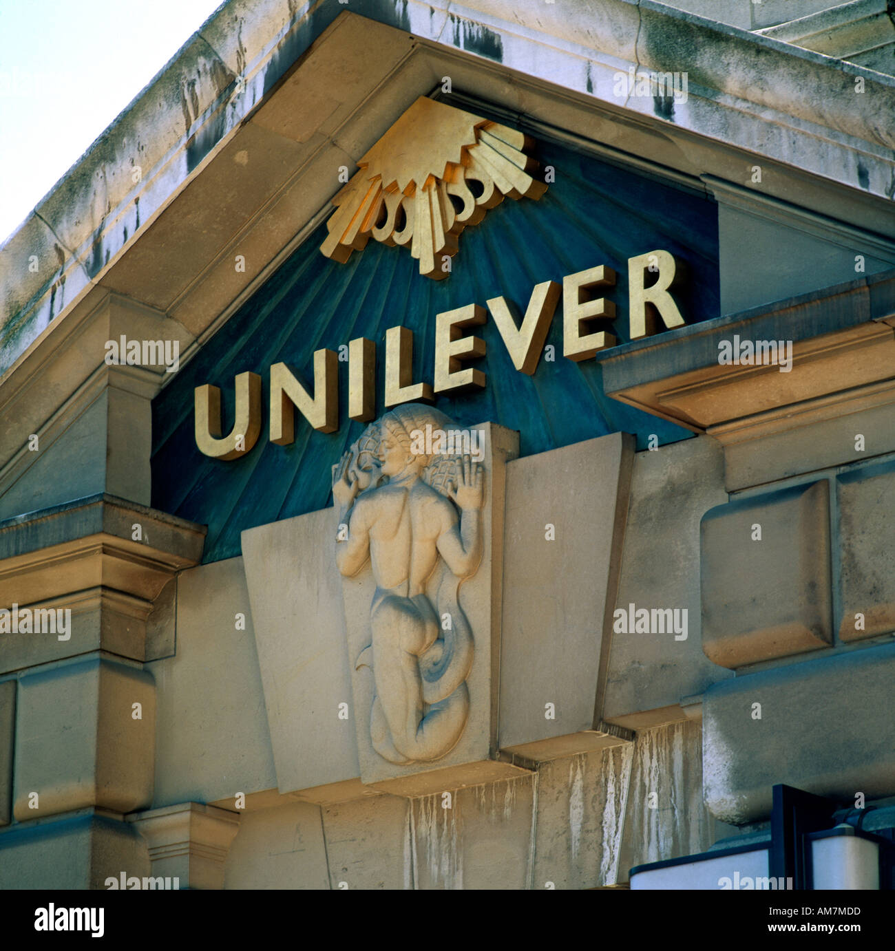 Sculpture on headquarters offices of Unilever with logo by River Thames River Thames City of London EC4 England  - Stock Image