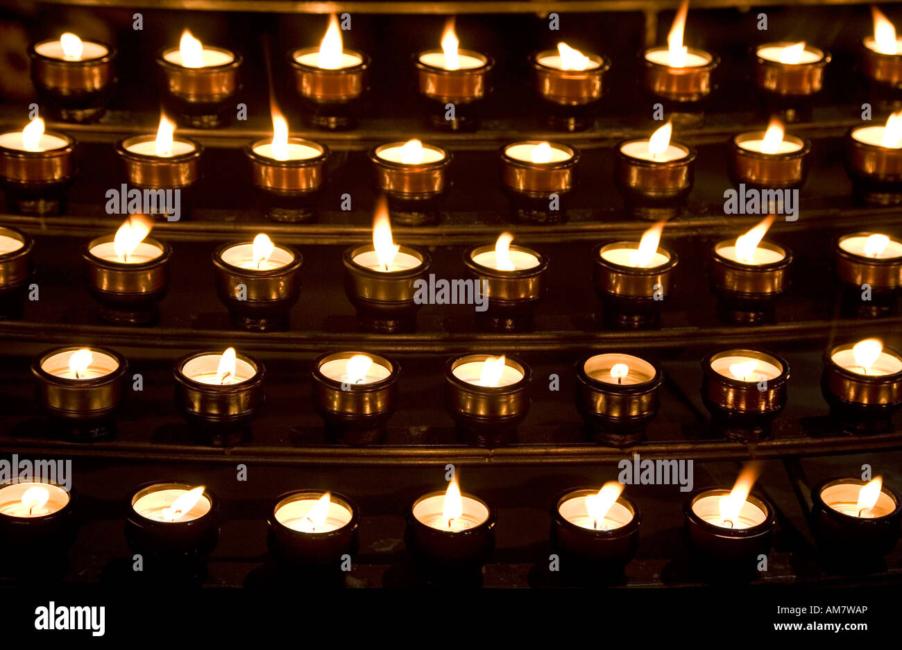 Many candles in a church - for All Saints' Day - Stock Image