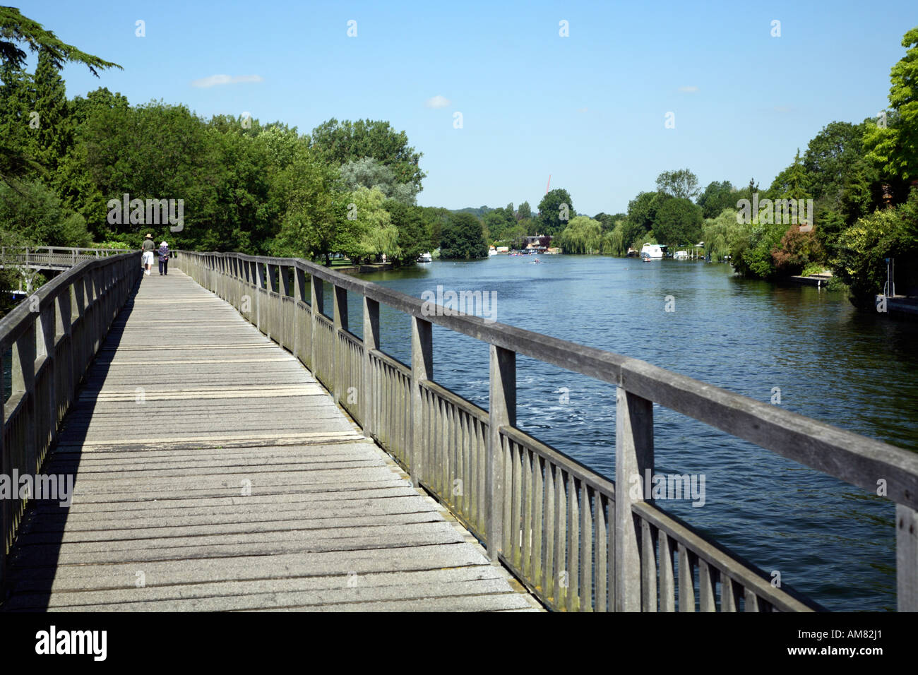 View from Henley weir footbridge looking downstream towards Henley town Stock Photo