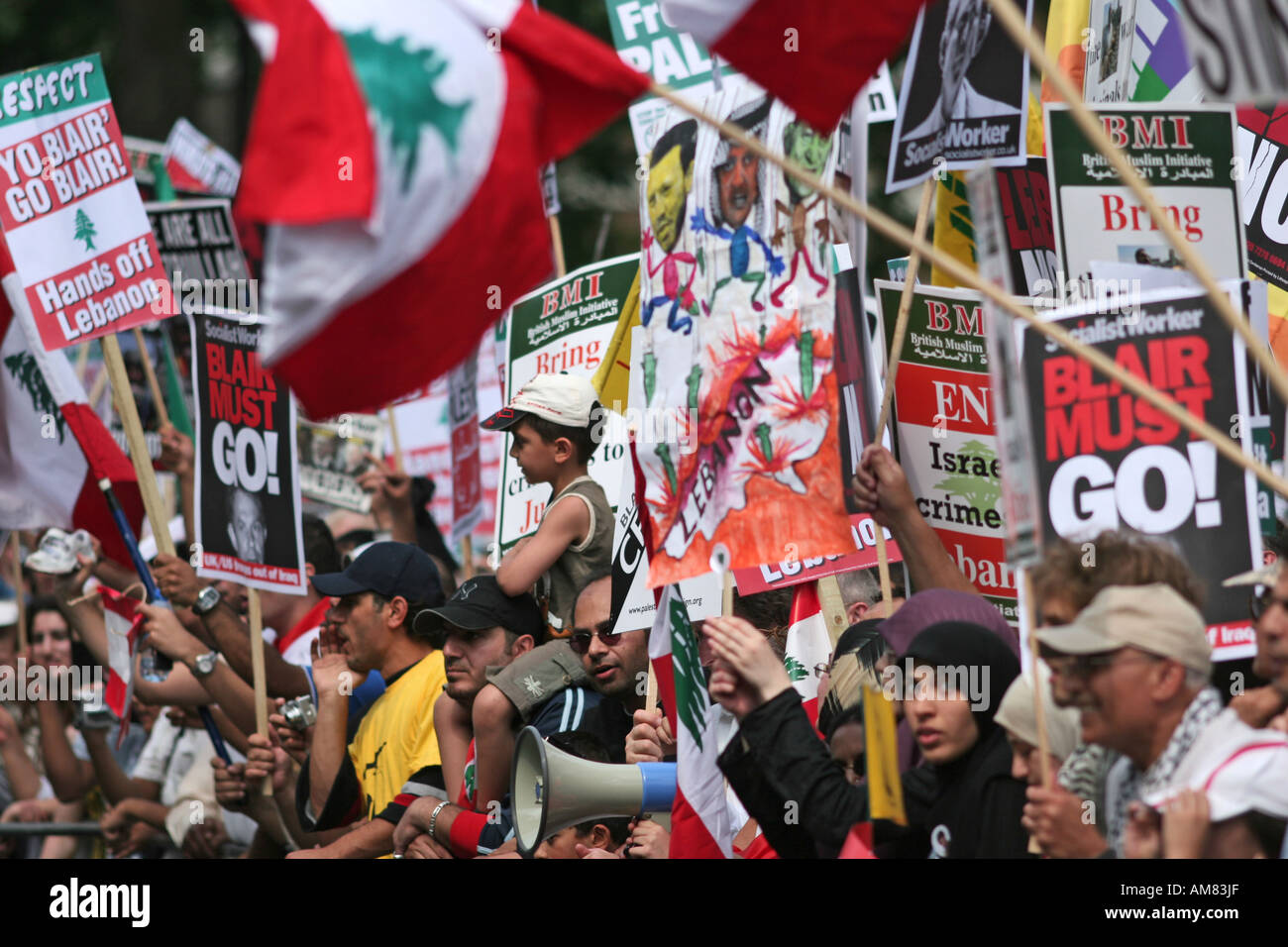 Protesters with placards at an anti-war demonstration in London UK - Stock Image