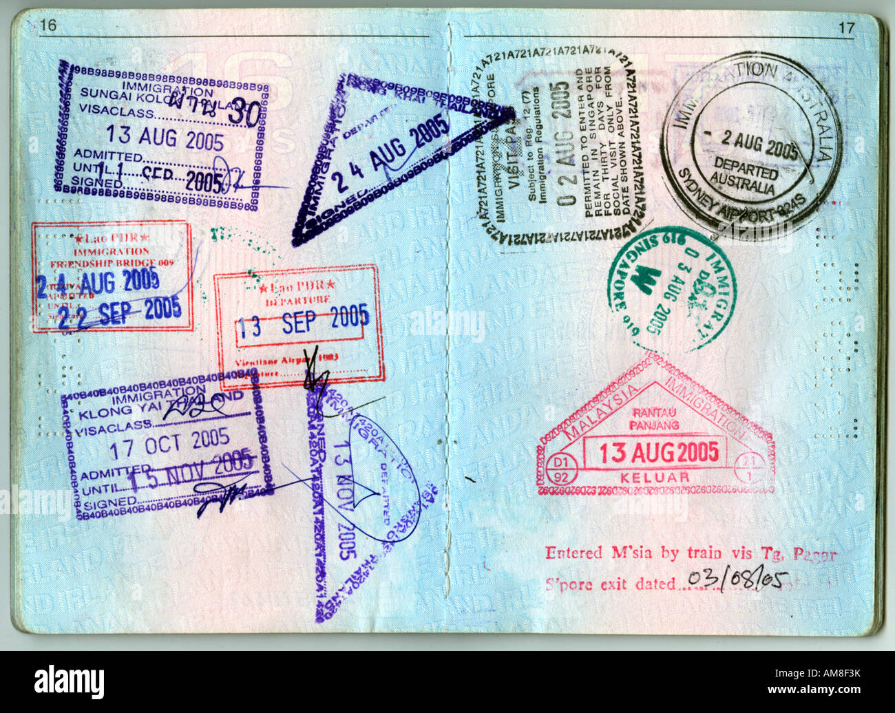 A high res scan of two pages of an Irish passport with visas