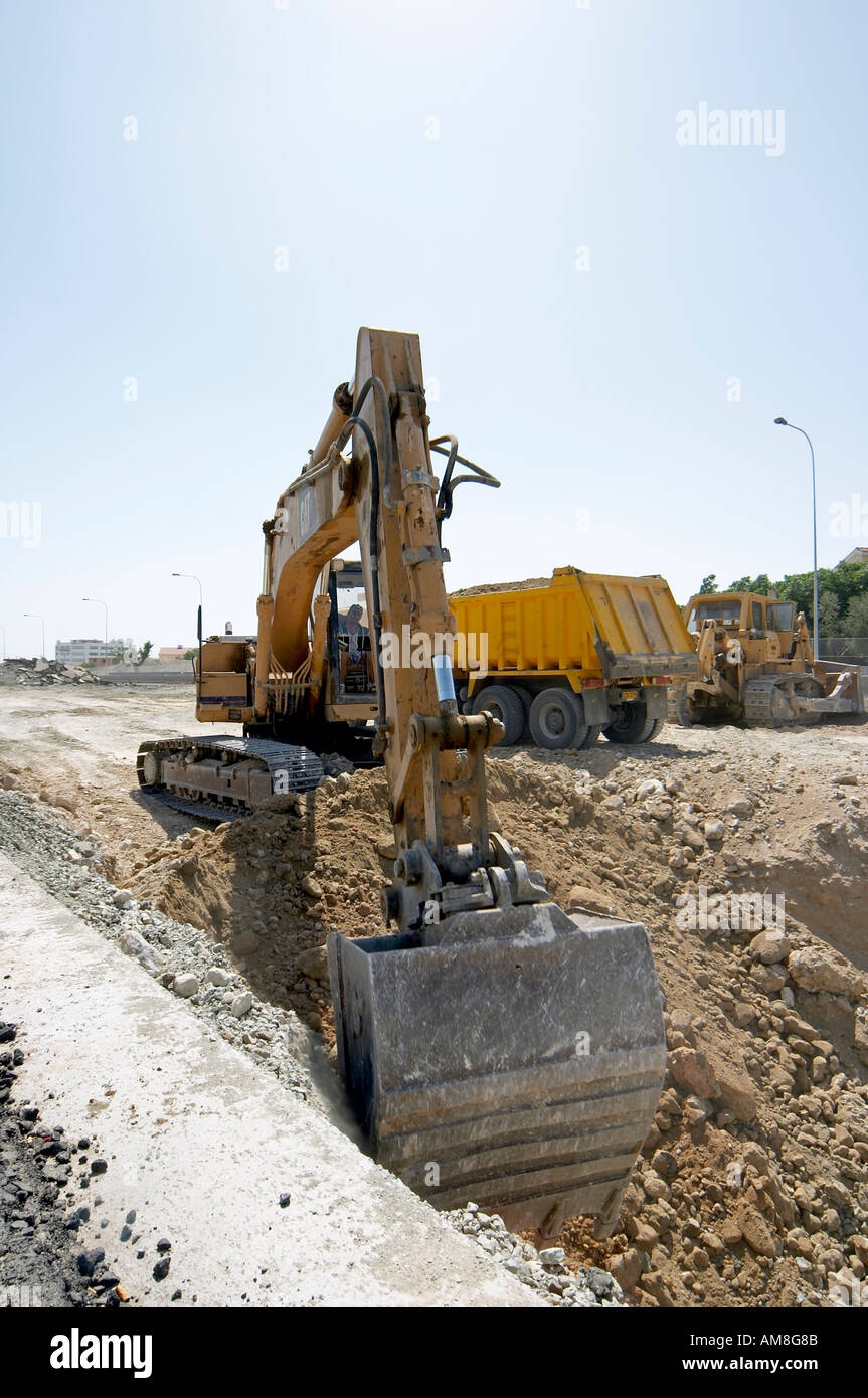 Excavator and dump truck Civil Engineering plant on Road