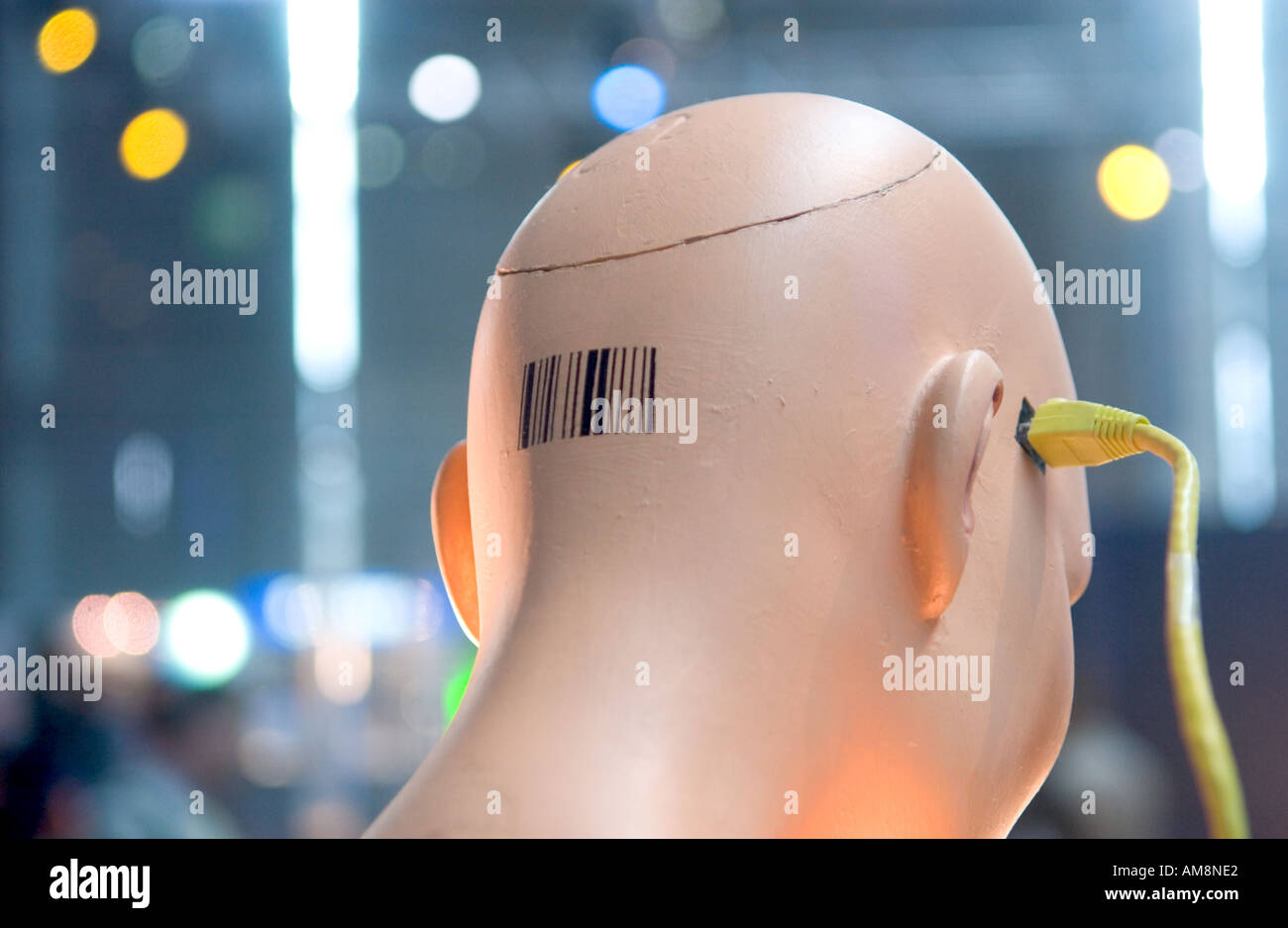 mannequin head with barcode connected to ethernet cable - Stock Image