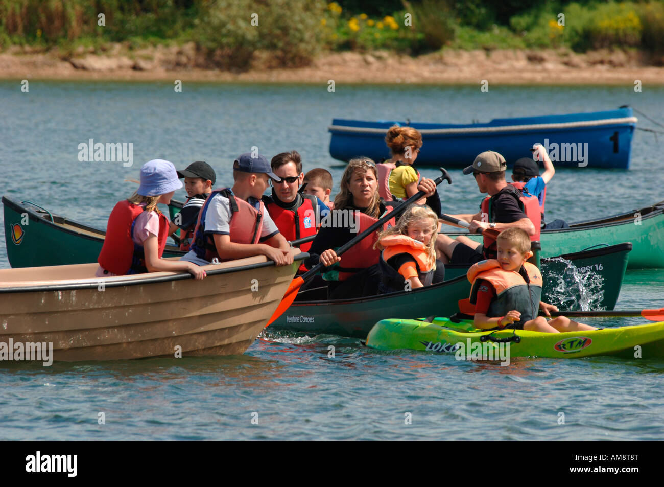 People In Boats,On carsington Water In Derbyshire England. Stock Photo