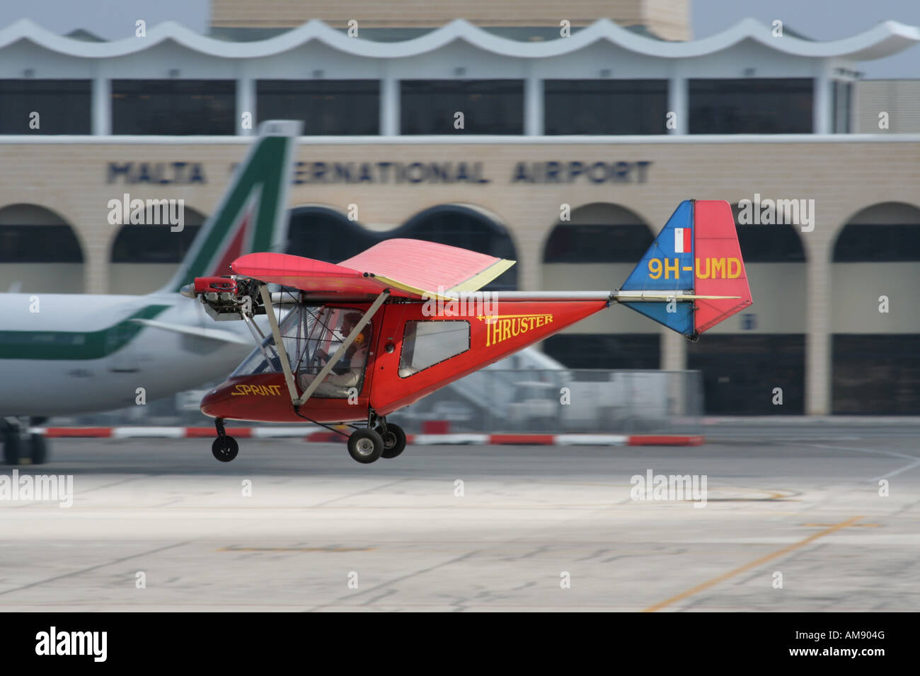 Thruster T-600N microlight aircraft overflying the runway at Malta International Airport - Stock Image