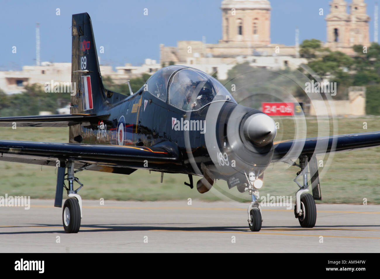 Shorts Tucano T1 single-engine turboprop trainer plane of the Royal Air Force taxiing after a display in Malta - Stock Image