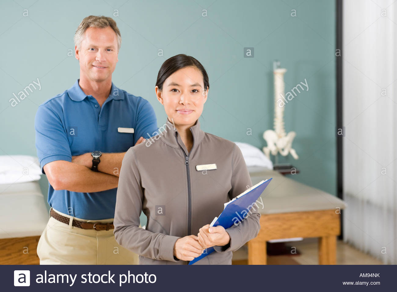 Multi-ethnic physical therapists in office - Stock Image