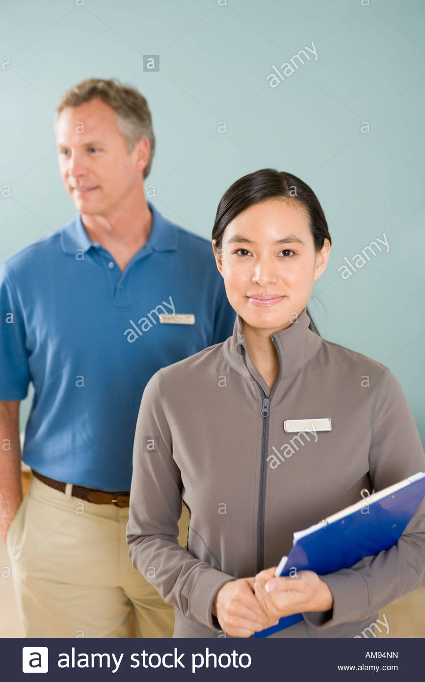 Multi-ethnic physical therapists indoors - Stock Image