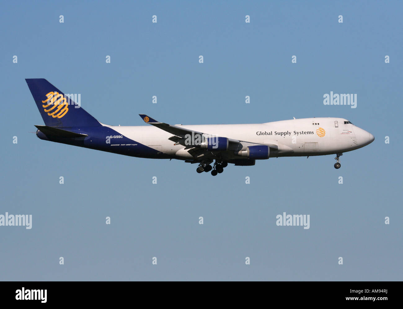 Commercial air freight transport. Global Supply Systems Boeing 747-400F cargo jet on approach - Stock Image
