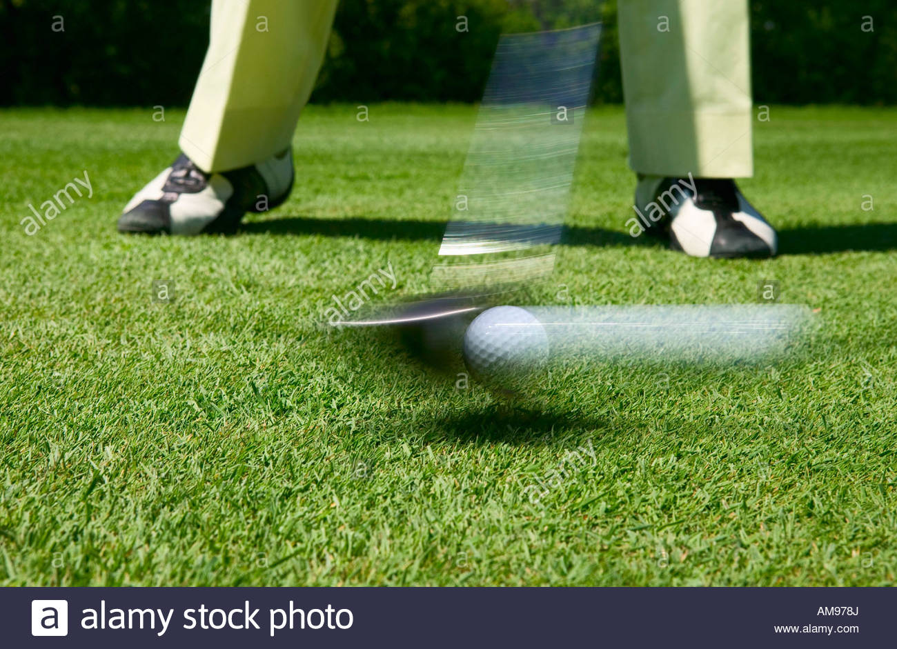 Person teeing off in blurred motion - Stock Image