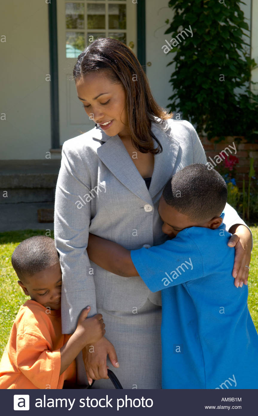 African mother hugging her sons - Stock Image