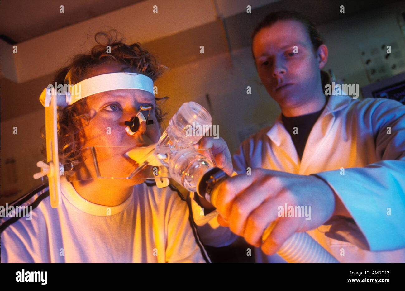 University students testing lung capacity. - Stock Image