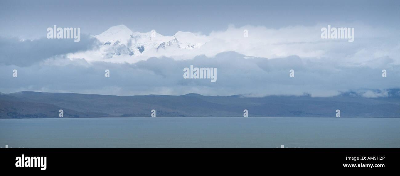 Lake Titicaca with a snow peaked Illampu, Bolivia - Stock Image