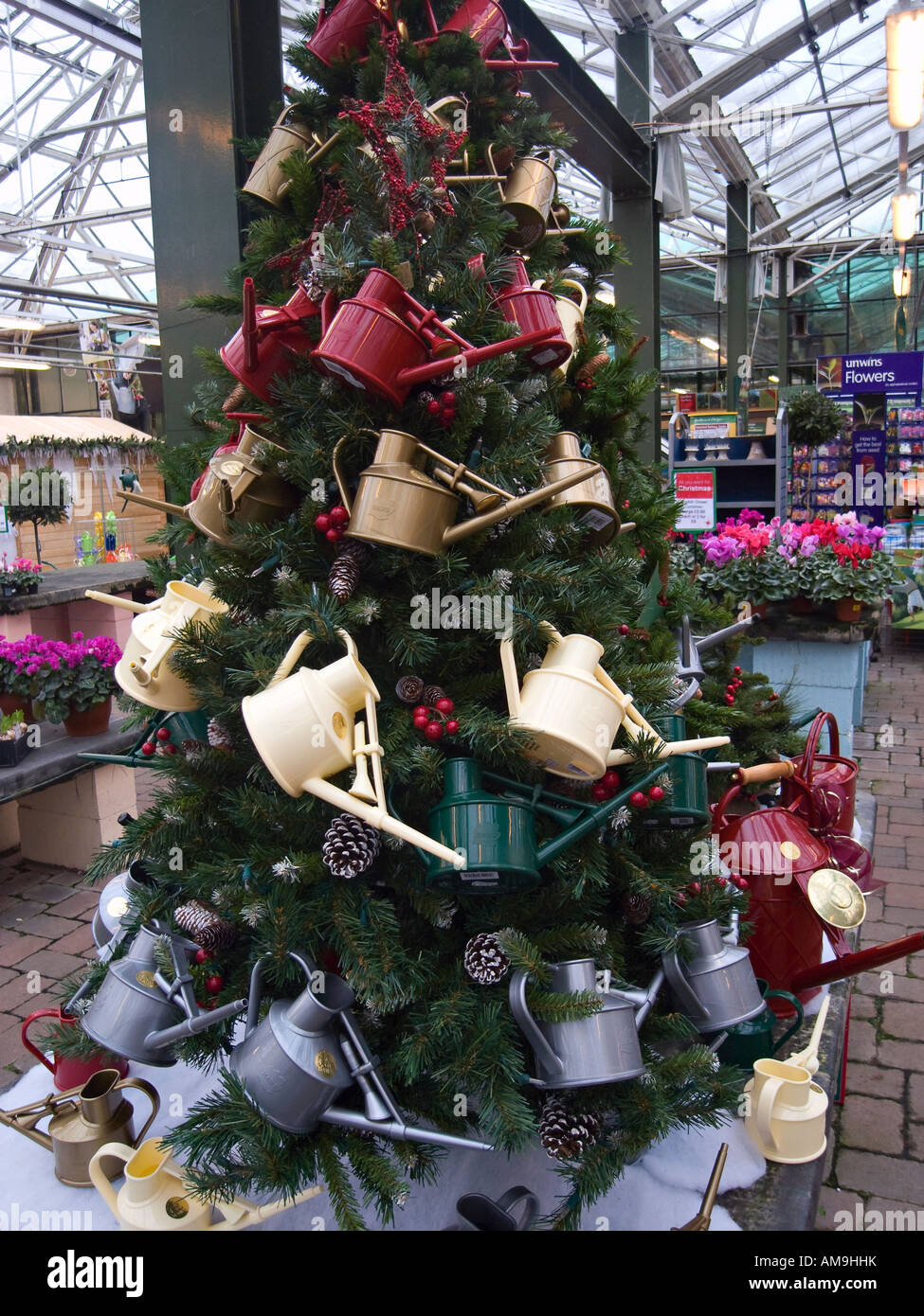 Unusual Christmas Tree With Colourful Watering Cans Used As Decorations