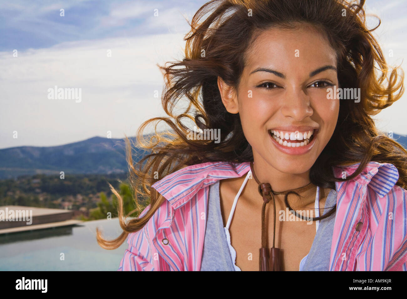 Natural beauty woman laughs outside in nature. - Stock Image