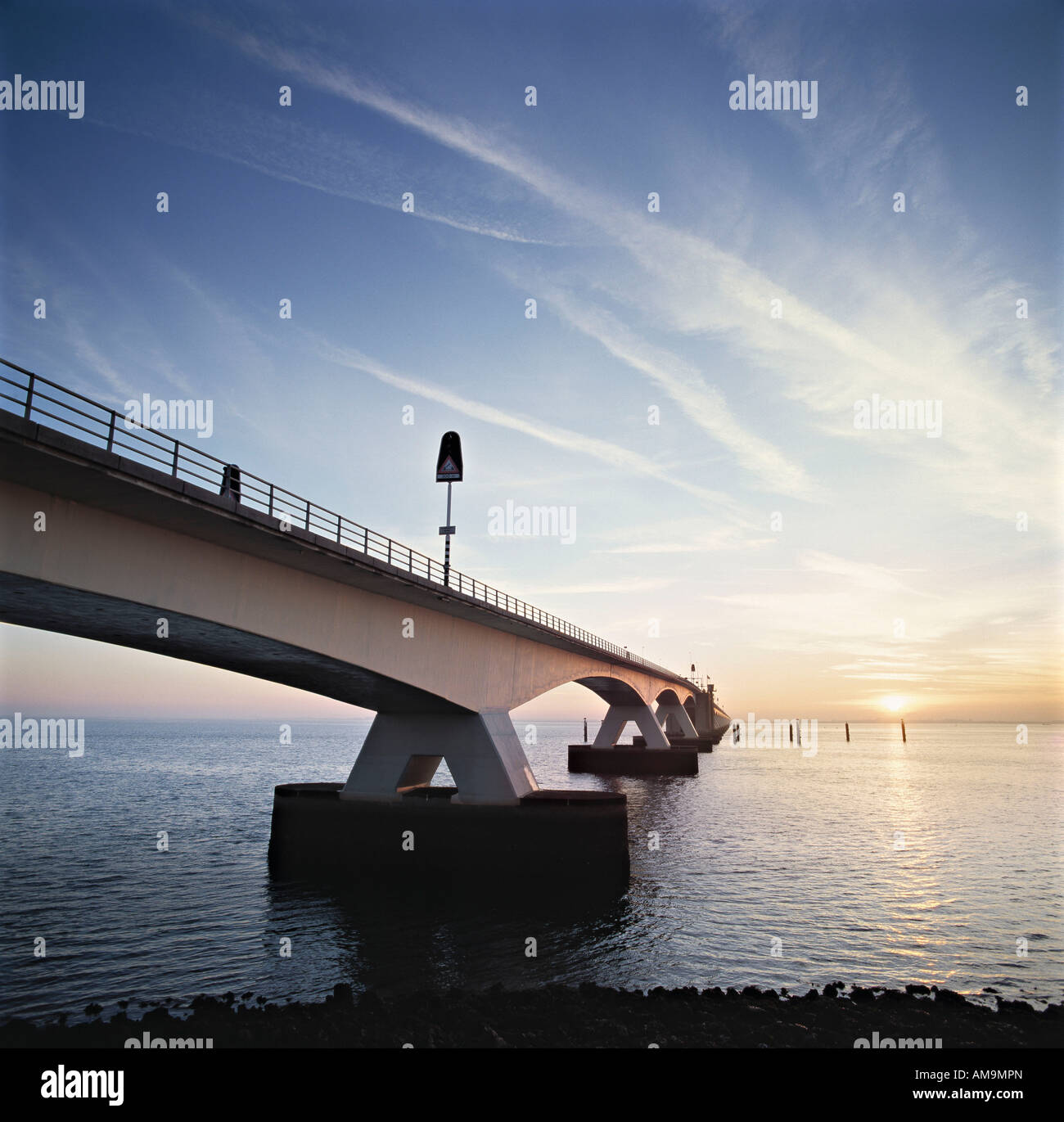A bridge over water in the Netherlands. - Stock Image