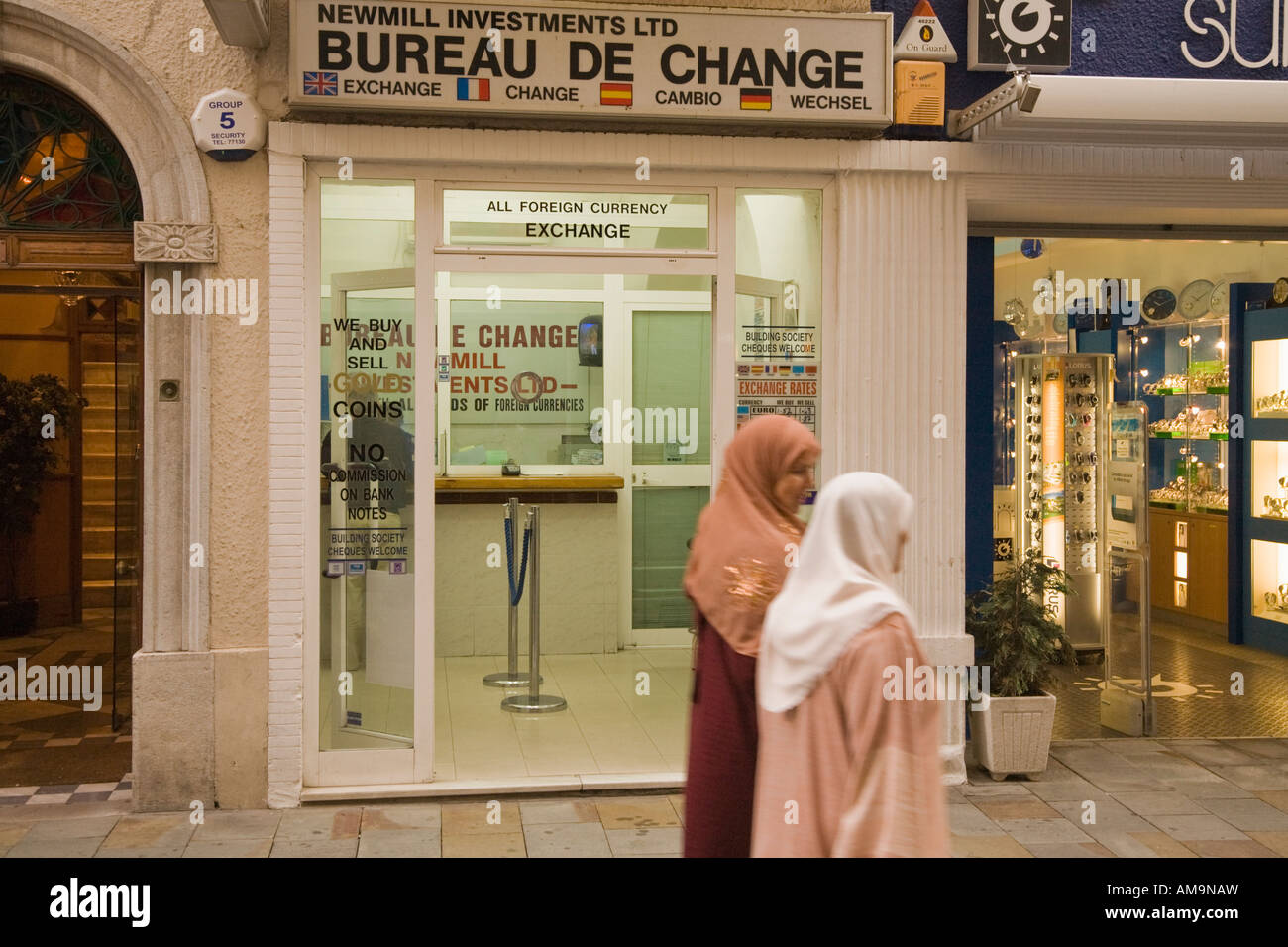 Gibraltar Two Moslem women passing change shop in Main Street - Stock Image