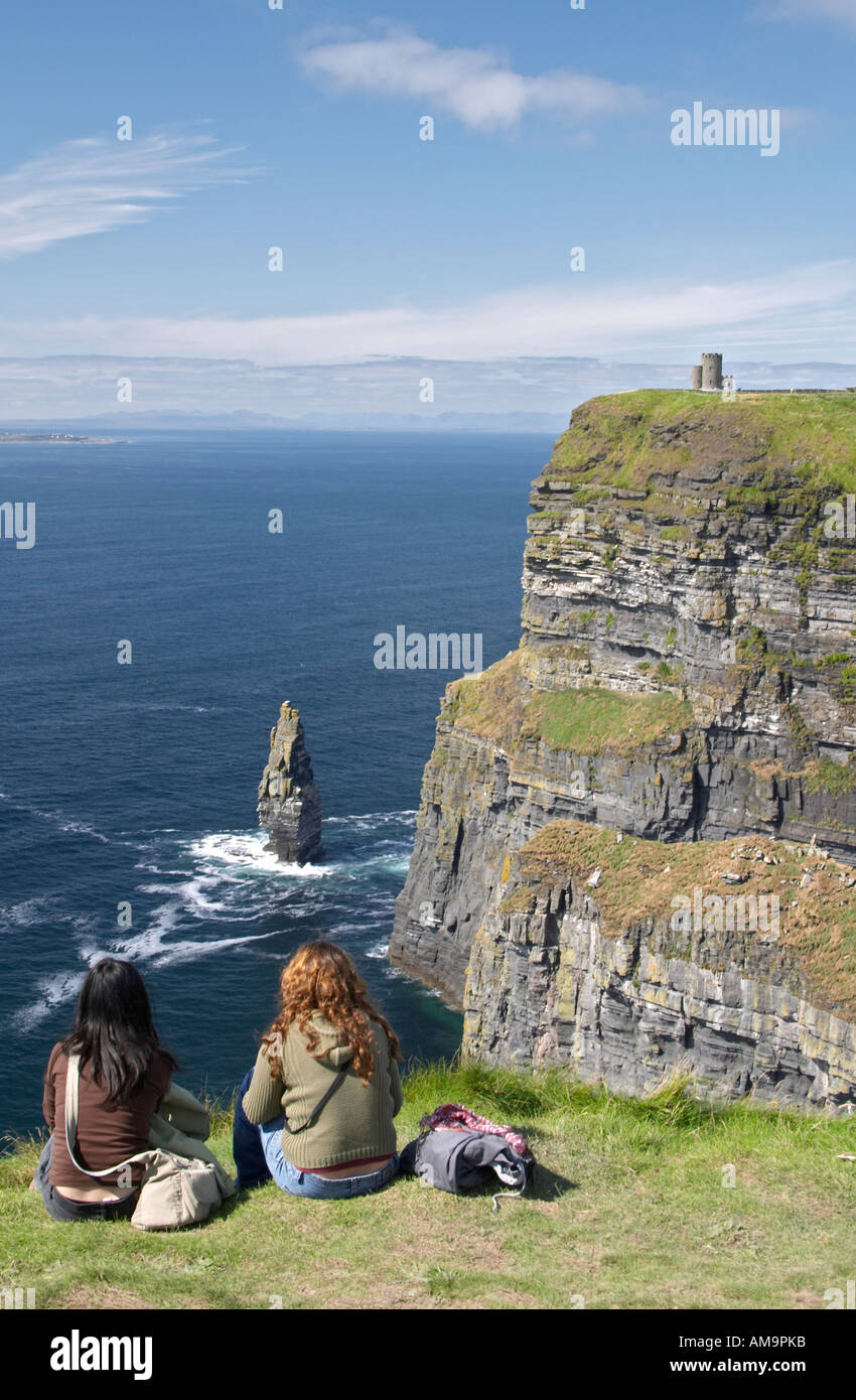 Girls looking at Cliffs of Moher Ireland - Stock Image