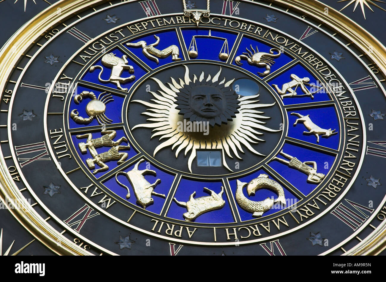 A zodiac clock with Winston Churchills face in the centre at Bracken House in London - Stock Image