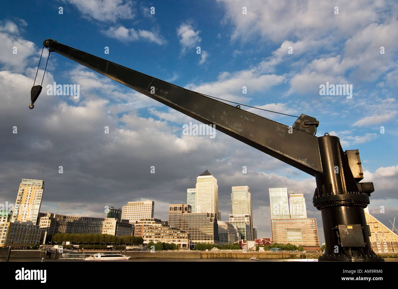 View through a winch across River Thames towards Canary Wharf complex Docklands London - Stock Image