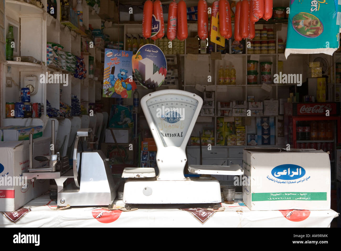 Shop counter with scales and goods on sale  in small town of Dakhla Oasis, Egypt North Africa - Stock Image