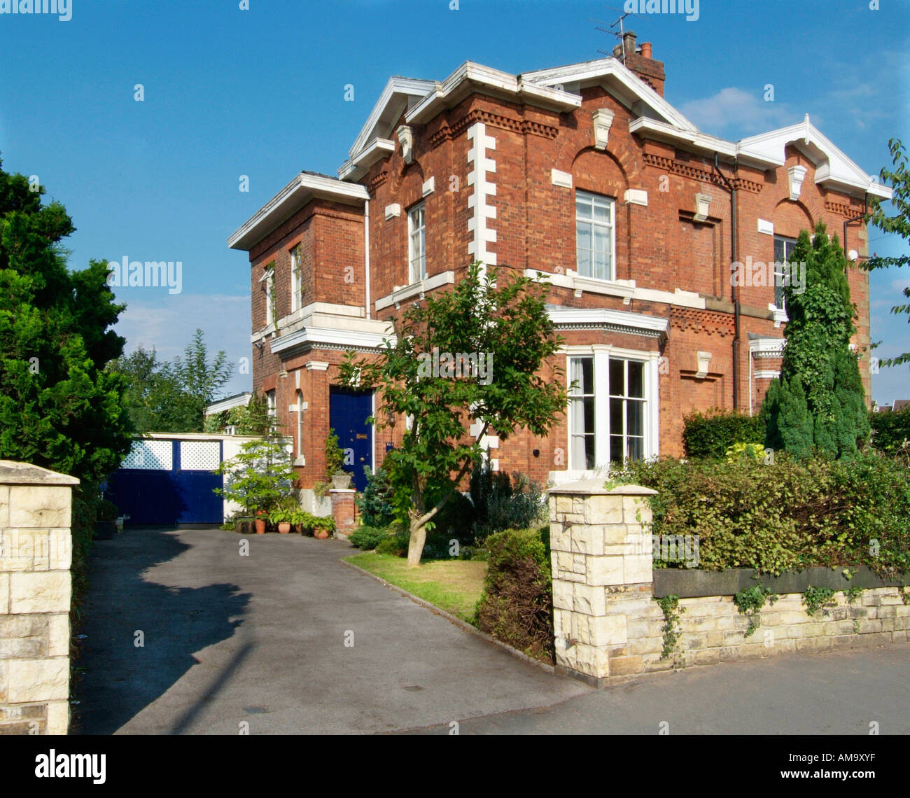 George Georgian town gentleman residence gatepost drive listed antique house home  domicile gate garden large semi detached - Stock Image