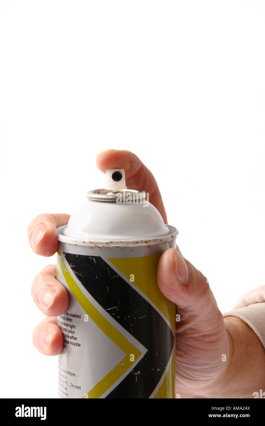 Hand holding an aerosol can with it pointing at camera. - Stock Image