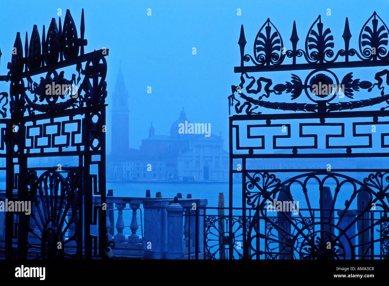 Italy Venice View of San Giorgio Maggiore from The Giardinetti Reali Royal gardens framed through an iron gate - Stock Image