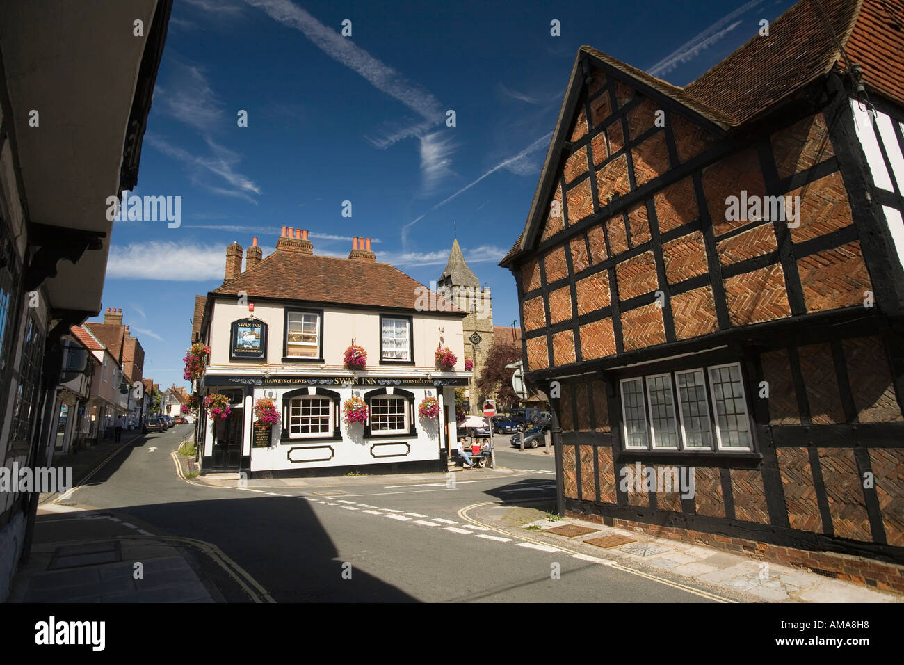 West Sussex South Downs Midhurst Swan Inn and Church of Mary Magdelene and St Denys - Stock Image