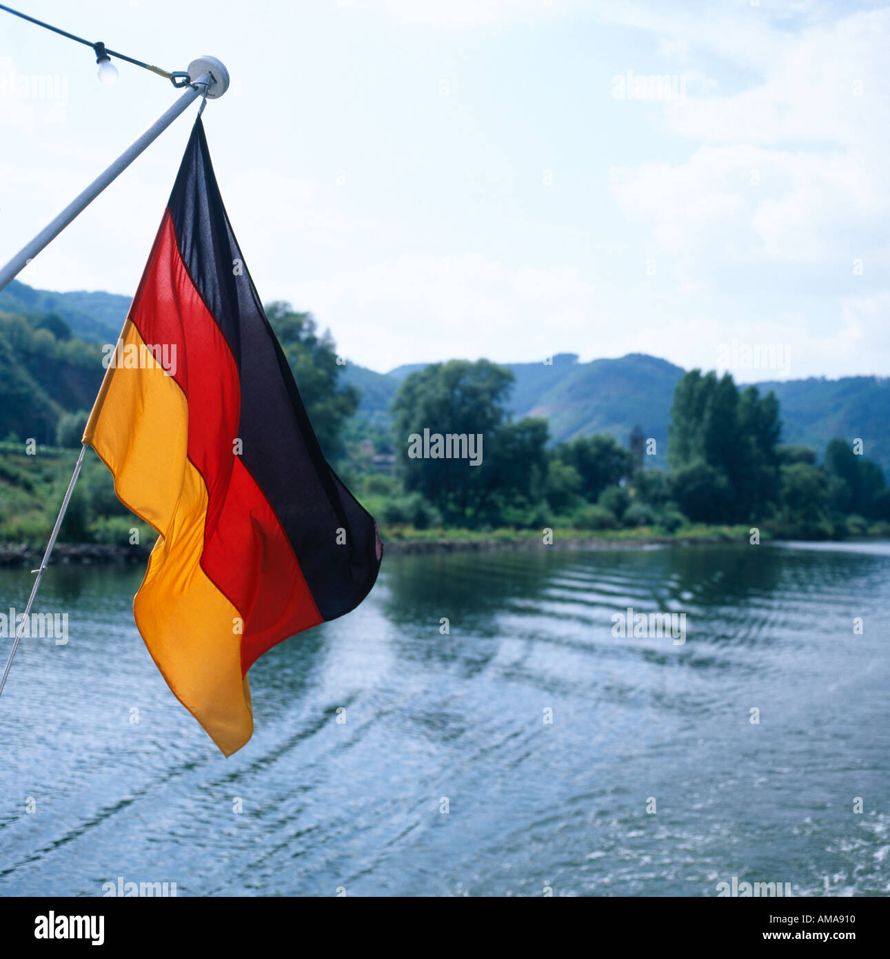 German flag on the back of a pleasure boat on the Mosel River Germany - Stock Image