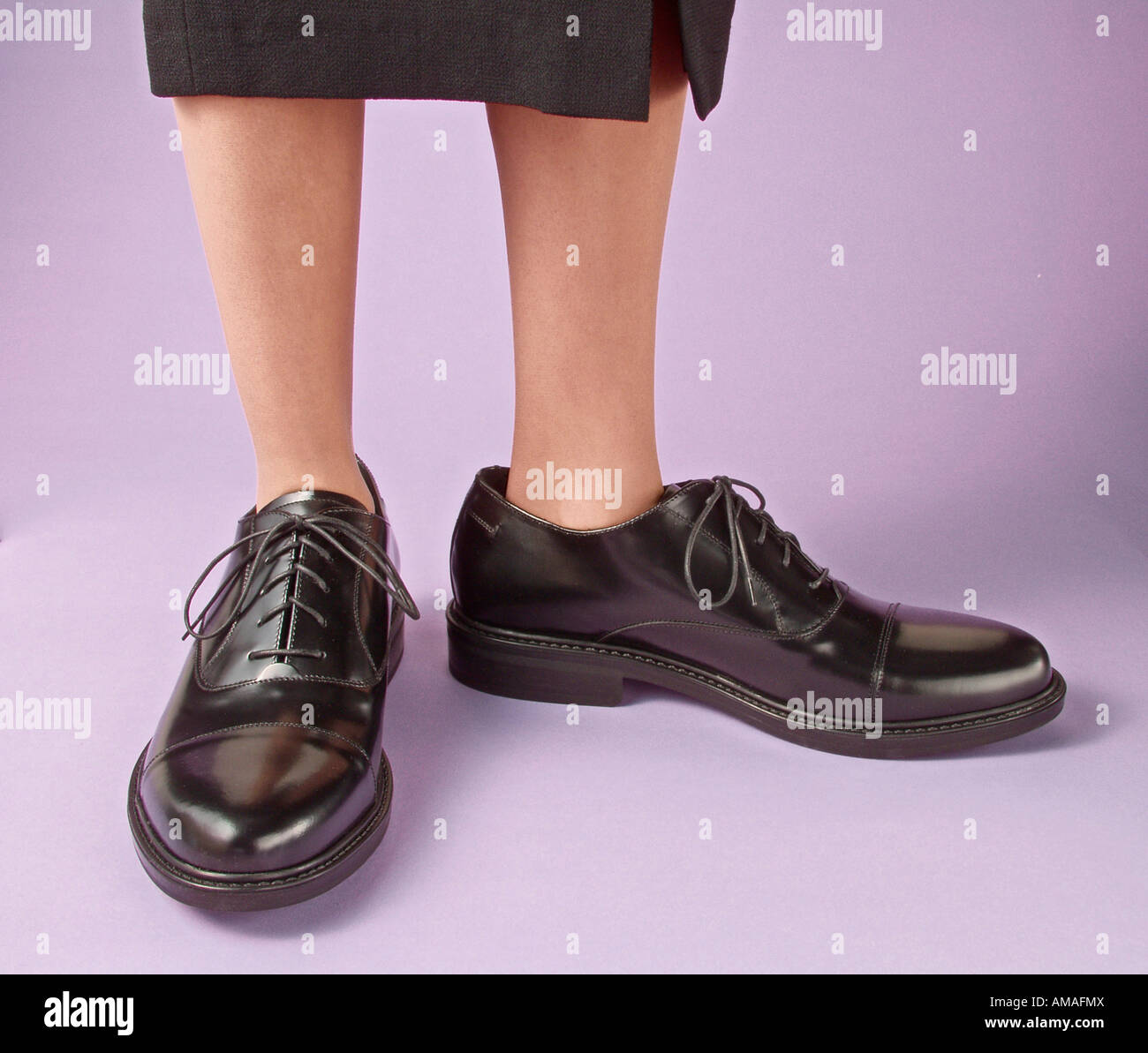 woman wearing large mens shoes Stock
