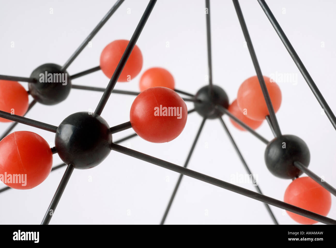 Close-up of molecular model on a white background - Stock Image