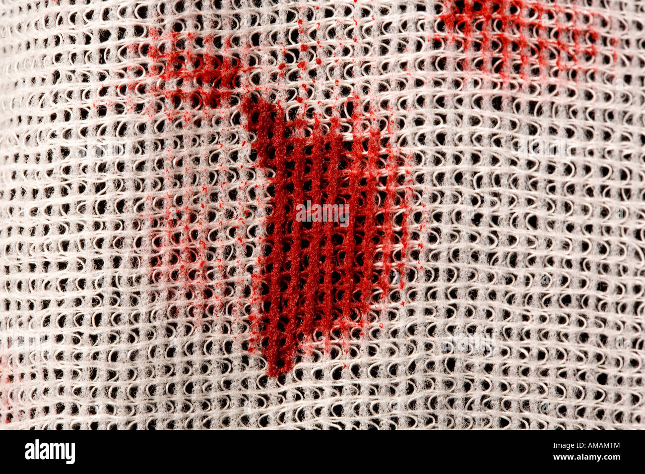 Blood stains on a bandage - Stock Image
