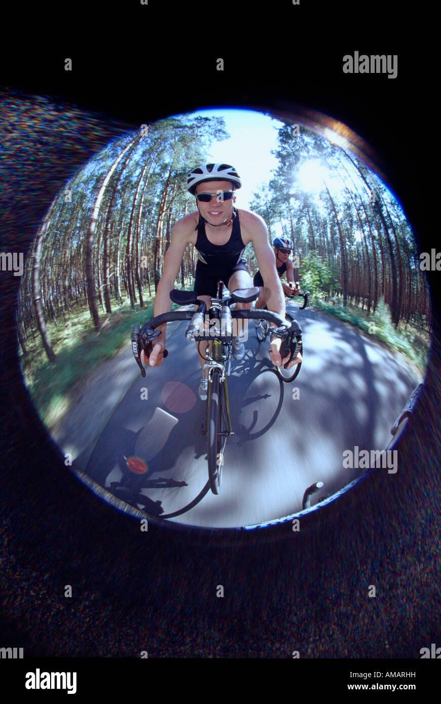 Teenage male triathlete cycling - Stock Image