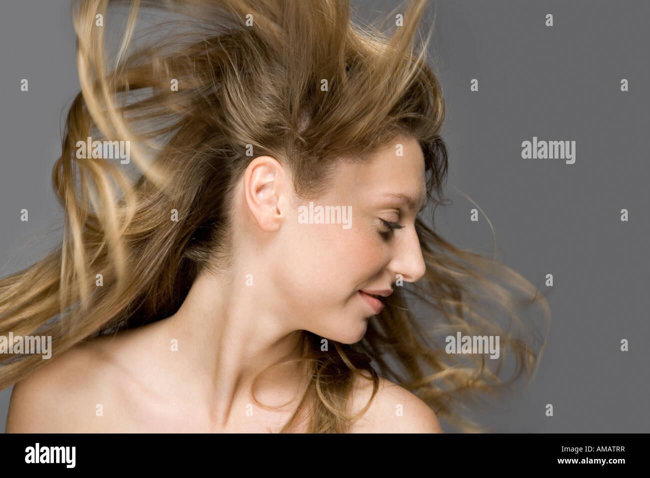 Air blowing through a fashion model's hair - Stock Image