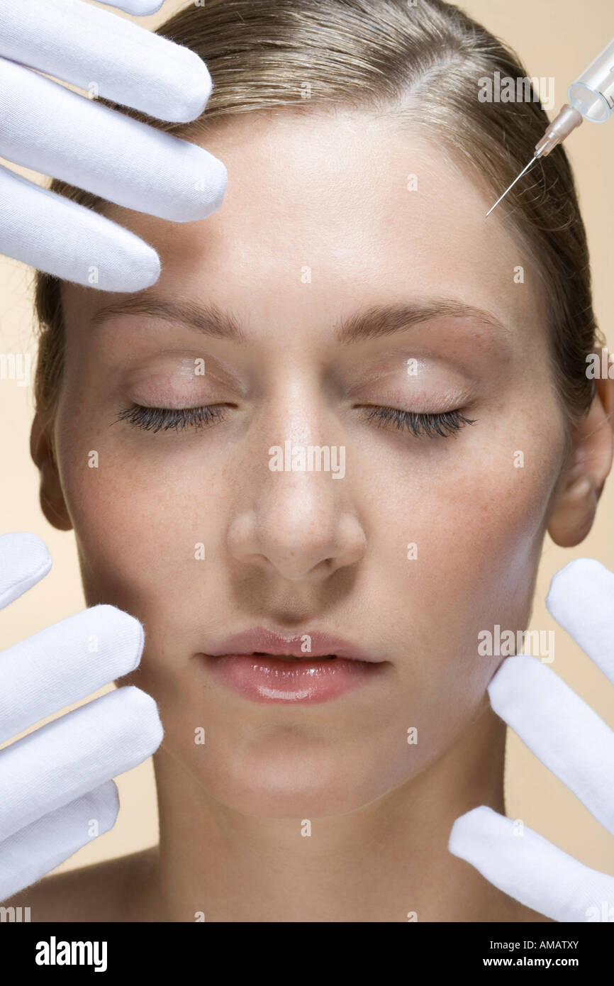 A woman having a collagen injection - Stock Image