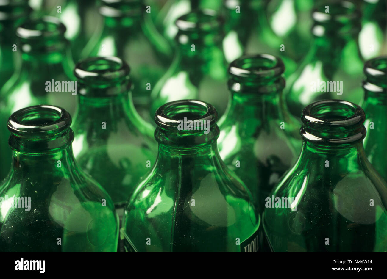 Green empty bottles waiting to be recycled - Stock Image