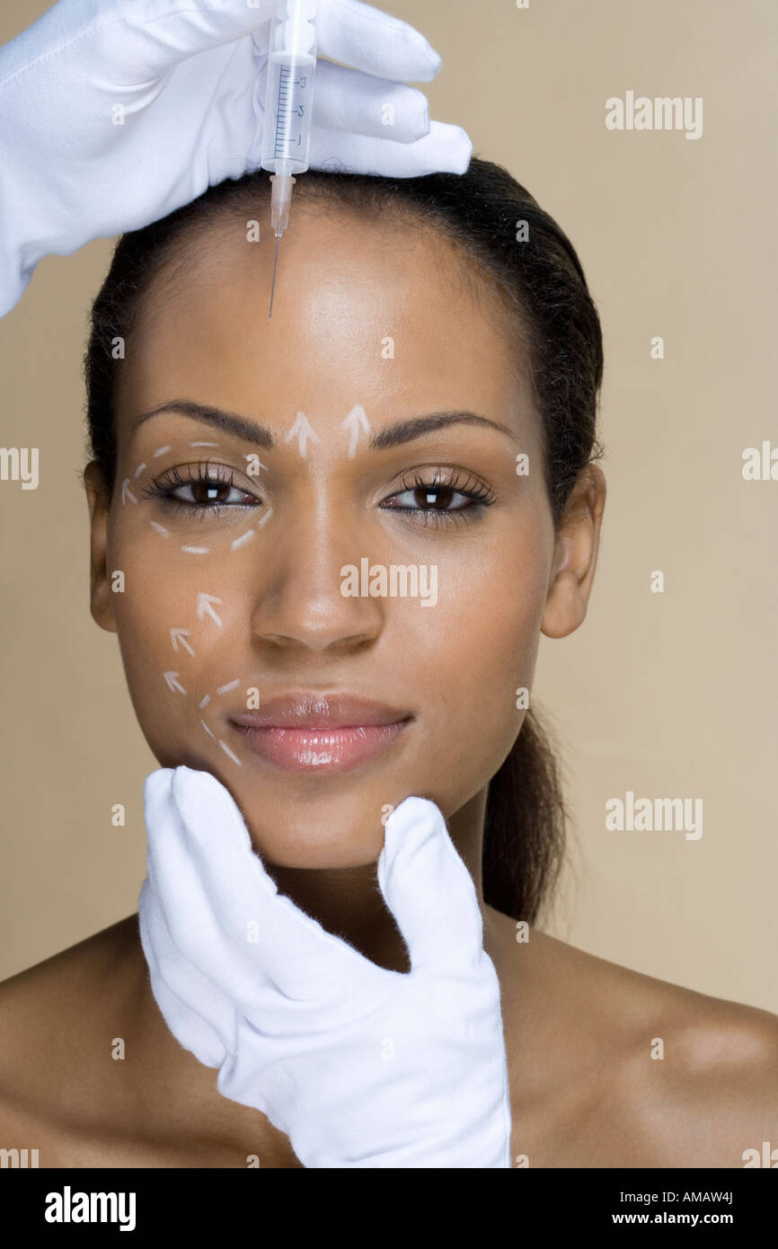 A woman having cosmetic surgery - Stock Image