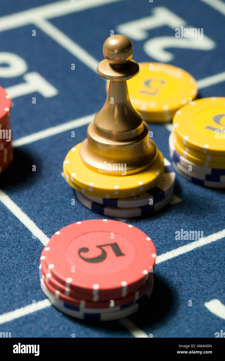 Stacks of gambling chips with Roulette Win Marker - Stock Image