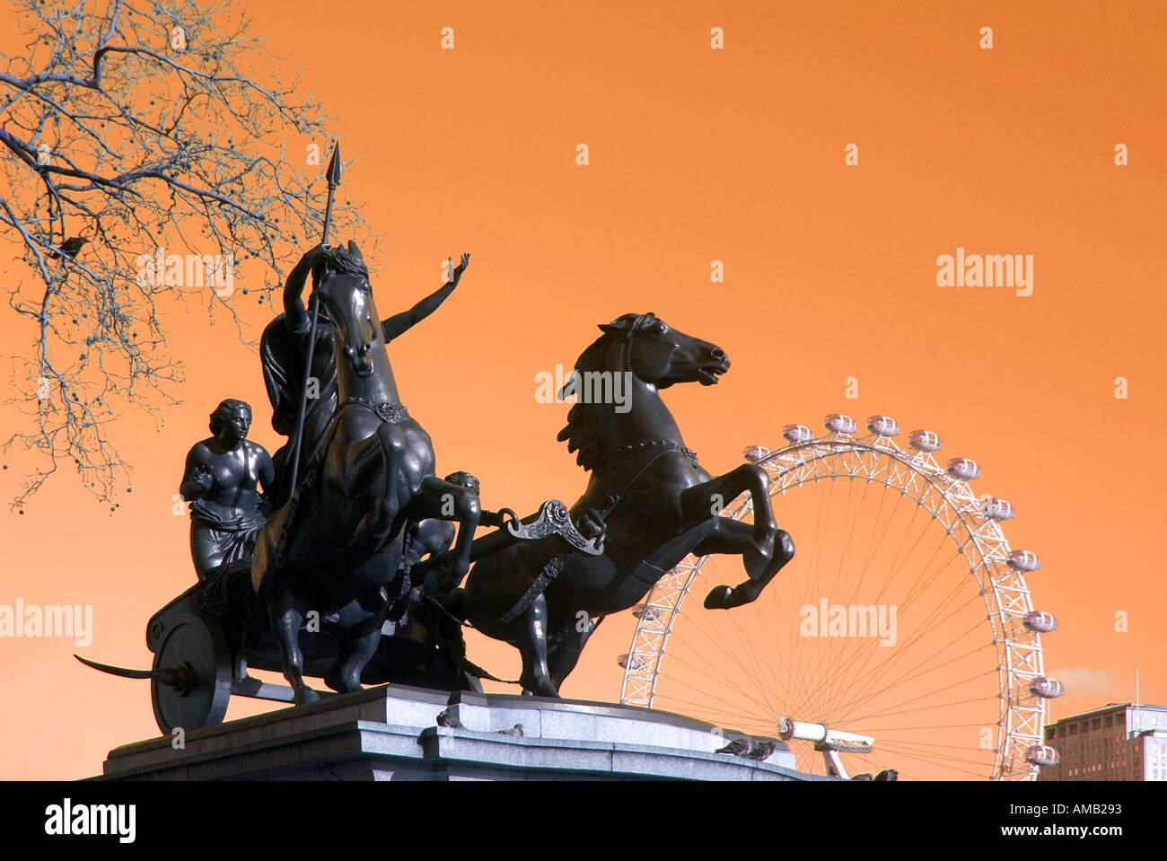 Bronze statue of Queen Boudicca and horse chariot with part of the London eye ferris wheel manipulated colour Stock Photo
