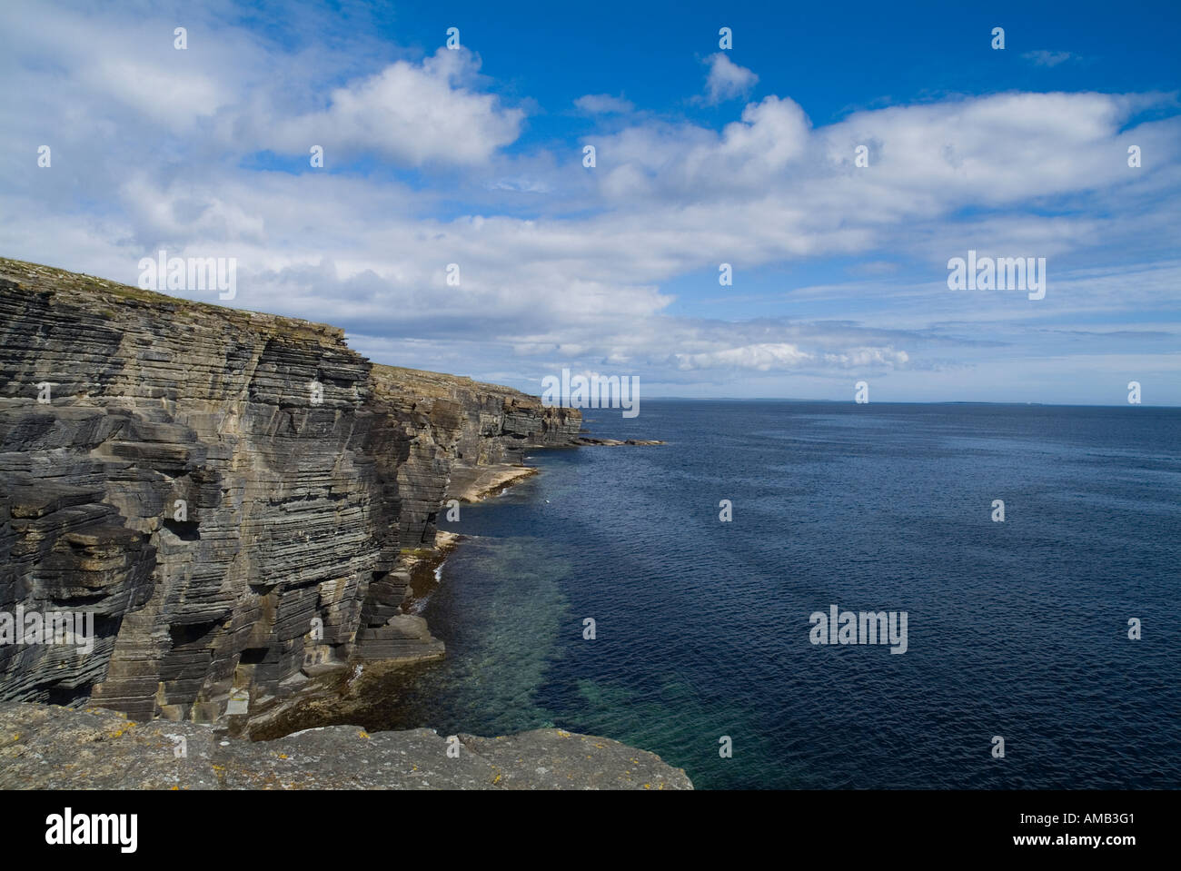 dh Clu Ber DEERNESS ORKNEY East coast seacliffs calm blue sea and sky rugged coastline summer Stock Photo