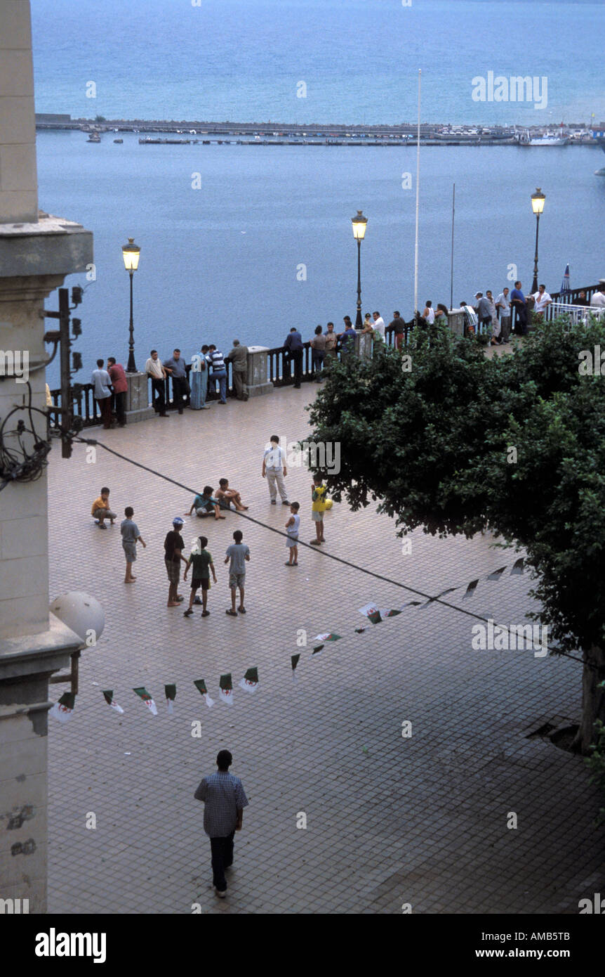 Evening shot of the Place Gueydon now Place du ler Novembre overlooking the port of Bejaia formerly Bougie in Algeria 2003 - Stock Image