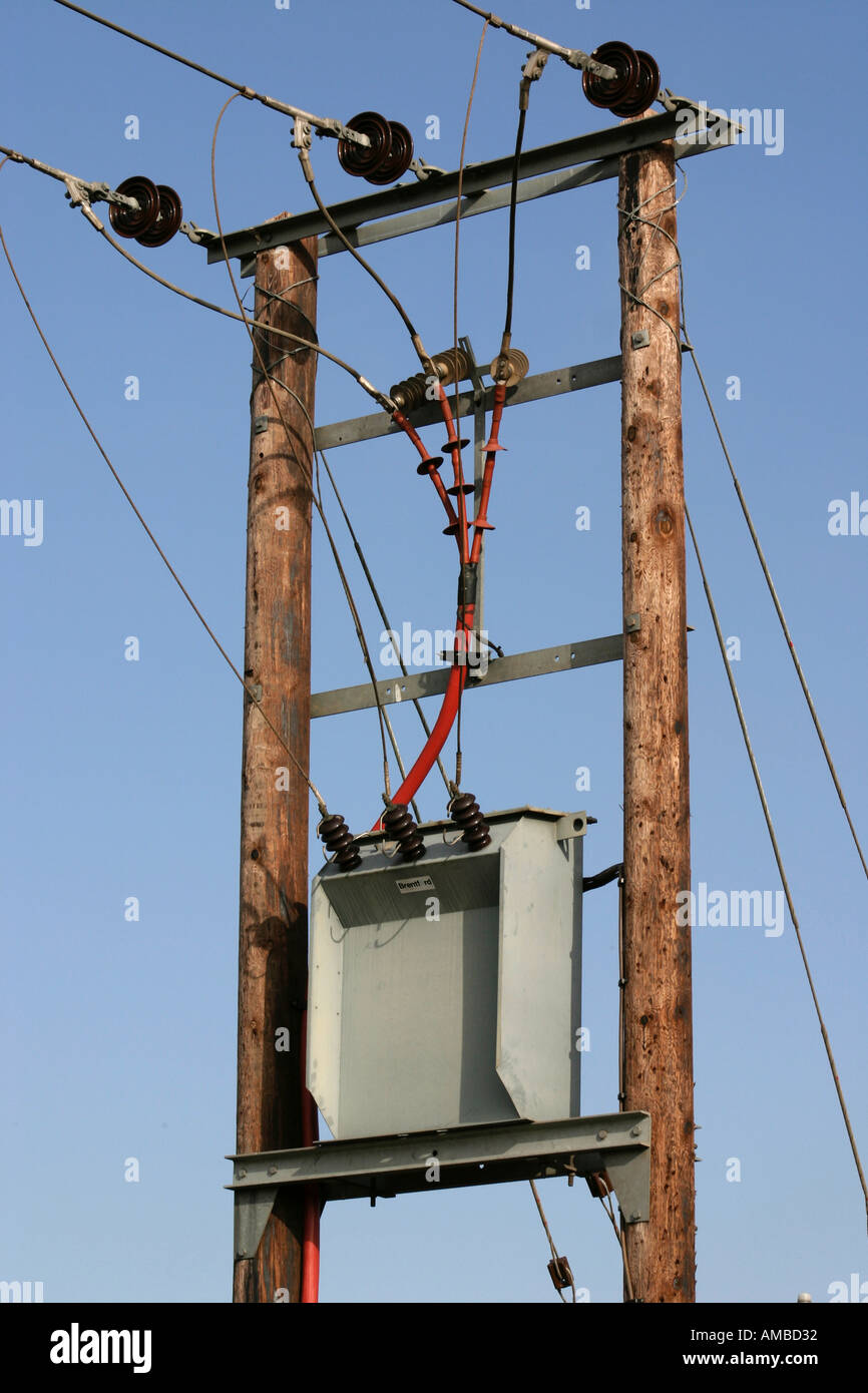 Three Phase Transformer and Power Cables on Support Poles Stock ...