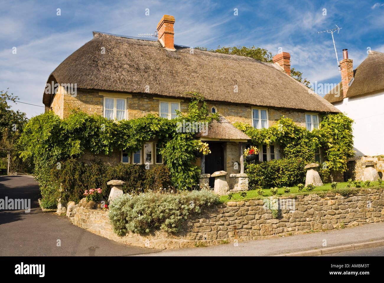 Thatched cottage at the village of Chideock, Dorset, UK - Thatched cottage house, England - Stock Image