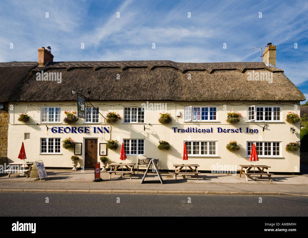 English country pub in the village of Chideock in West Dorset, England, UK - Stock Image