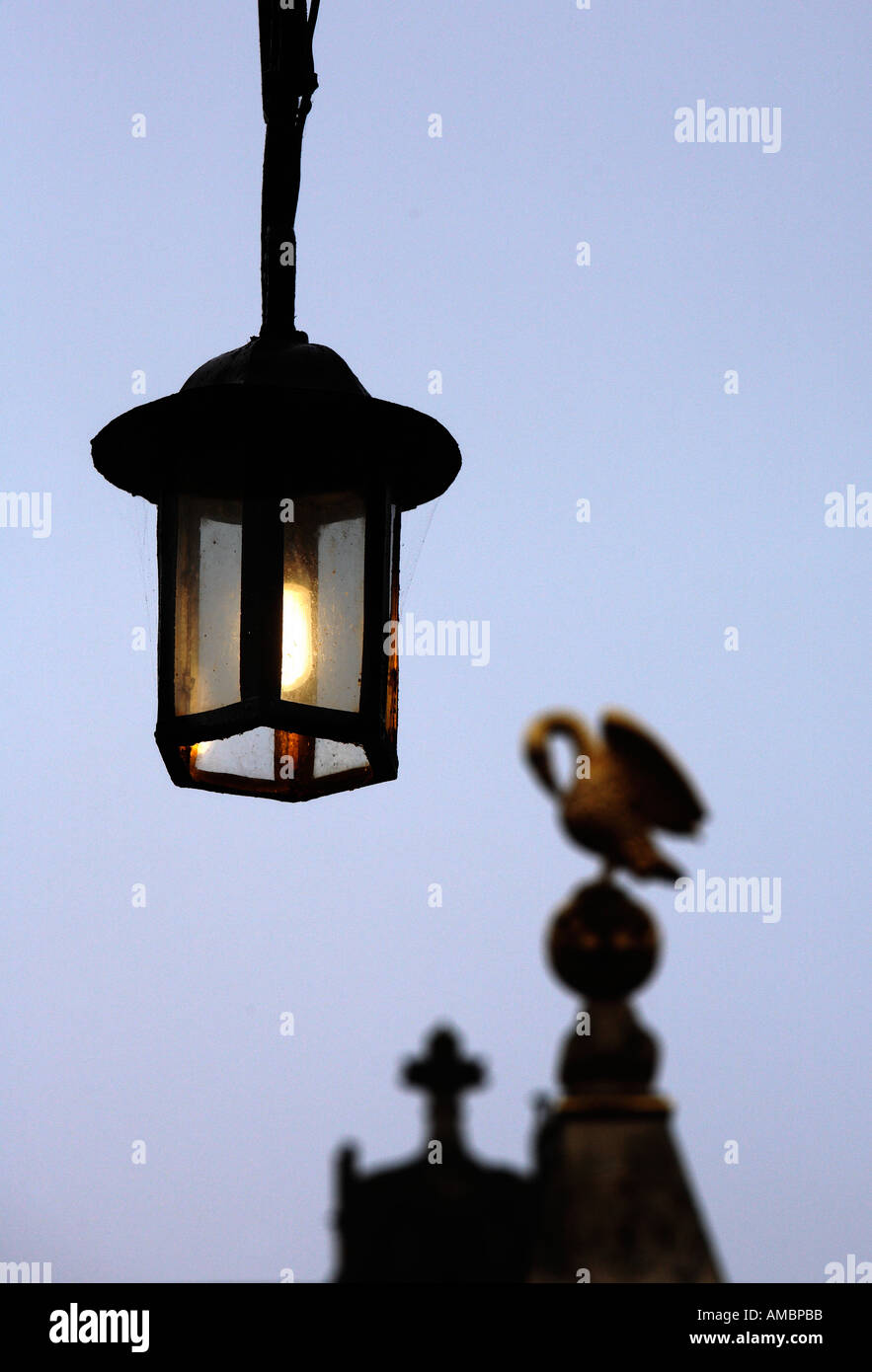 Lamp and swan at Corpus Christi College Oxford - Stock Image